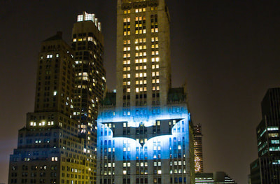 Bat-signal projected onto building in Manhattan